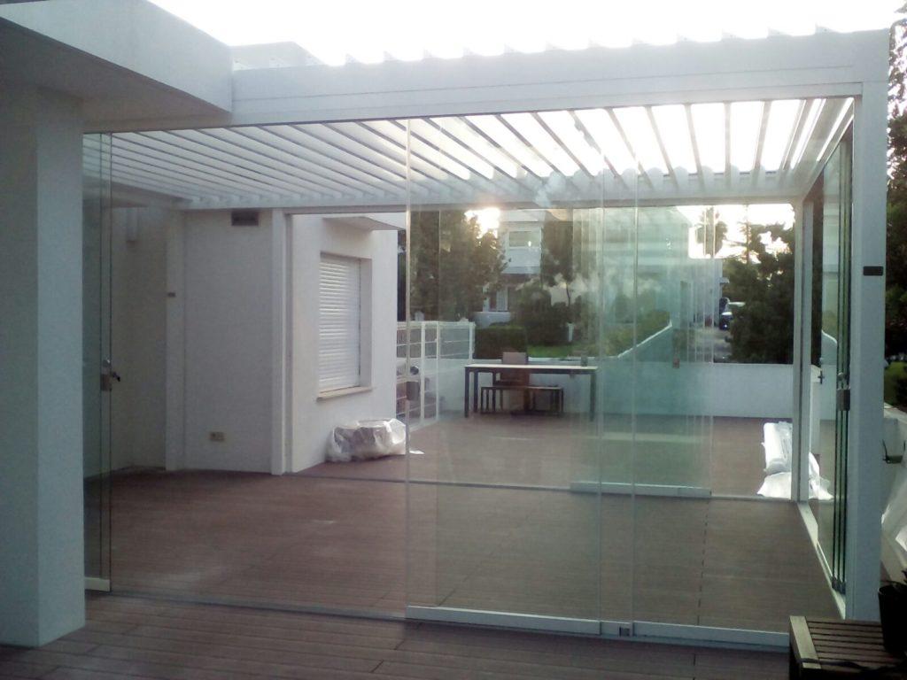Sistemglass cerramientos y cortinas de cristal puertas for Cortinas de cristal para terrazas